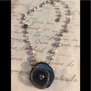 Fresh water pearl pendant/enamel birdsnest